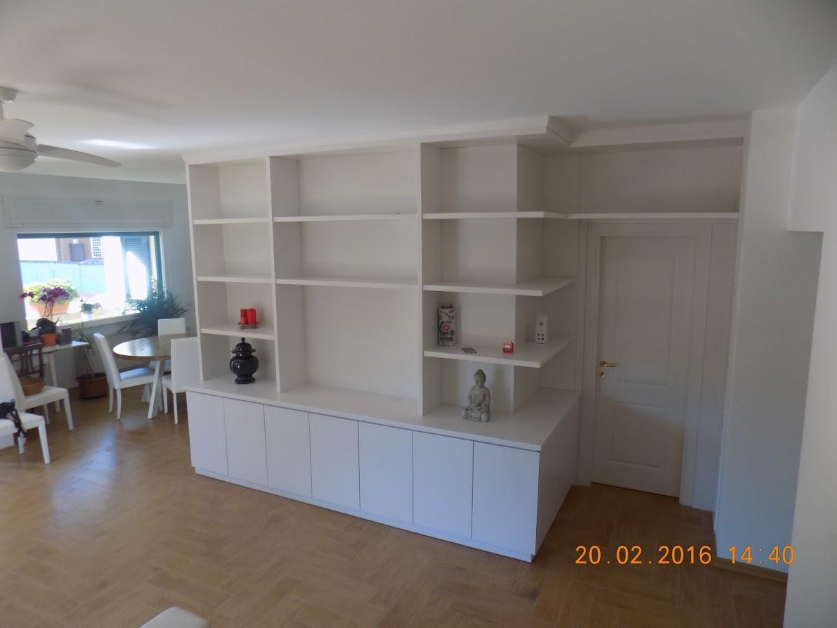 Libreria ad angolo in listellare – Falegnameria Capozi – Falegname ...